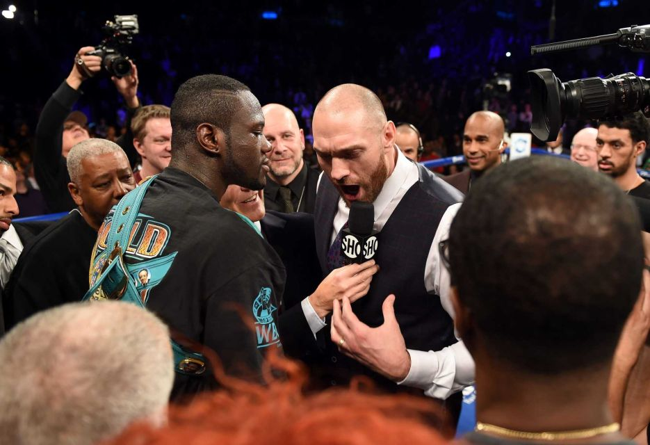 Tyson Fury break up the party when he gets in the ring and states his case for a fight with Wilder  Credit: Getty Images/ DON EMMERT STF