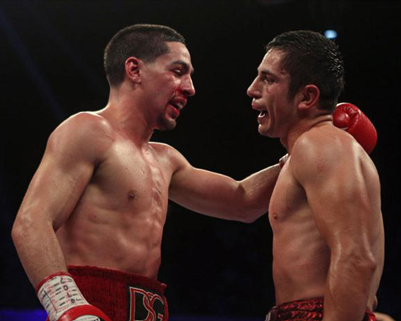 Danny Garcia embraces Herrera after a tough fight which many ringside felt he lost.