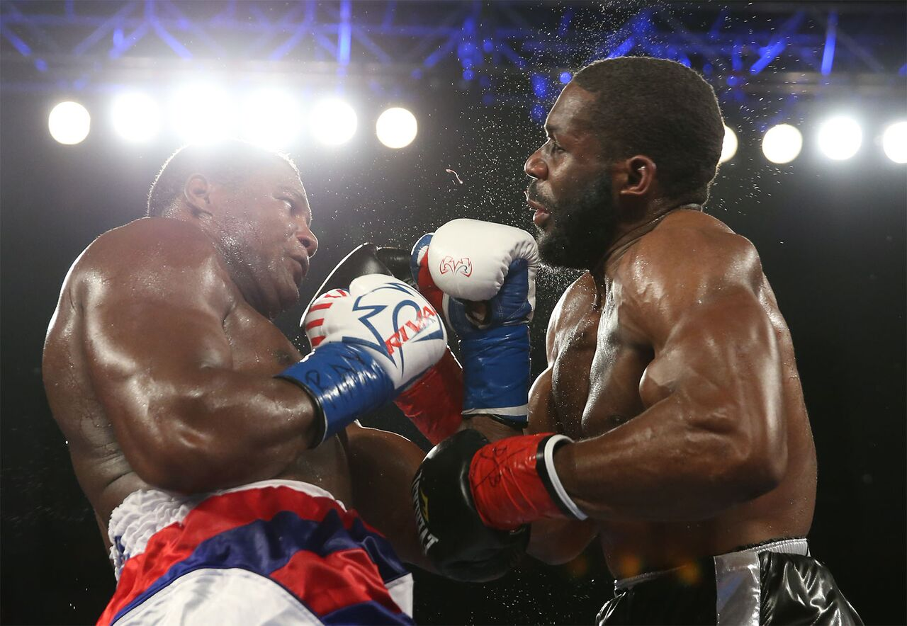 Luis Ortiz lands a devastating uppercut to the chin of Bryant Jennings. Photo credit: ALex Menendez