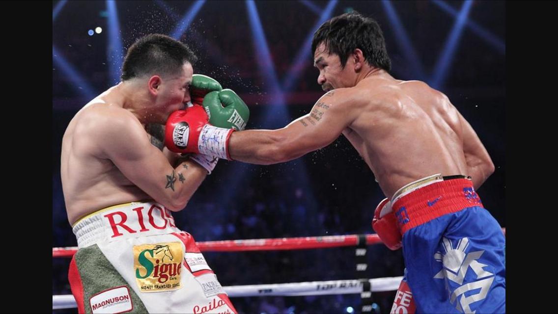 Pacquiao lands a left hand on Brandon Rios. Photo: Chris Farina/Top Rank