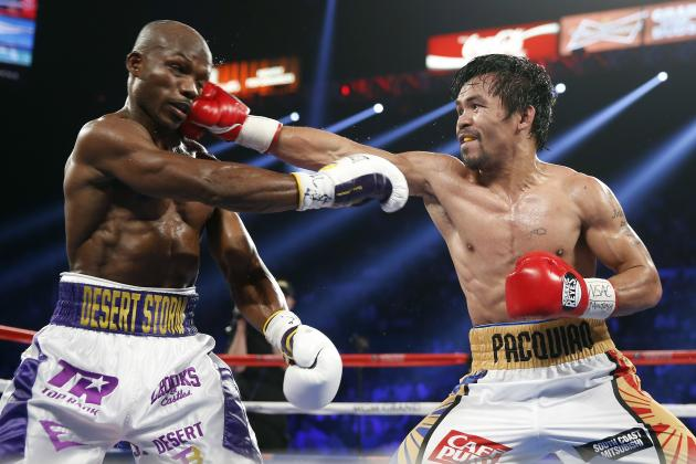 Manny Pacquiao lands a straight right hand against Tim Bradley Jr. on April 9, 2016. Photo: Isaac Brekken/Associated Press.