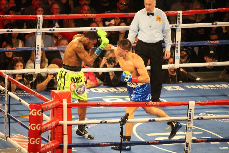 Gennady Golovkin lands a right hook through the guard of Dominic Wade. Photo: Harvey Feliciano - Z-BoxingNews/FrontProofMedia . com