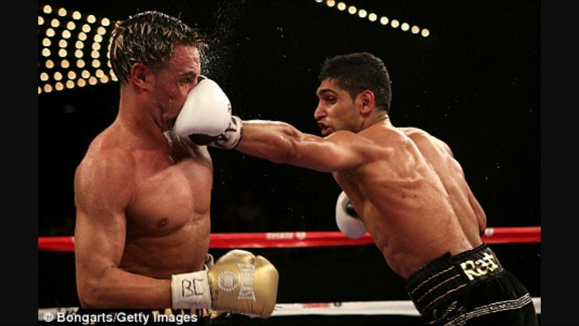 Khan smashes Malignaggi's face with a jab. Photo: Bongarts/Getty Images