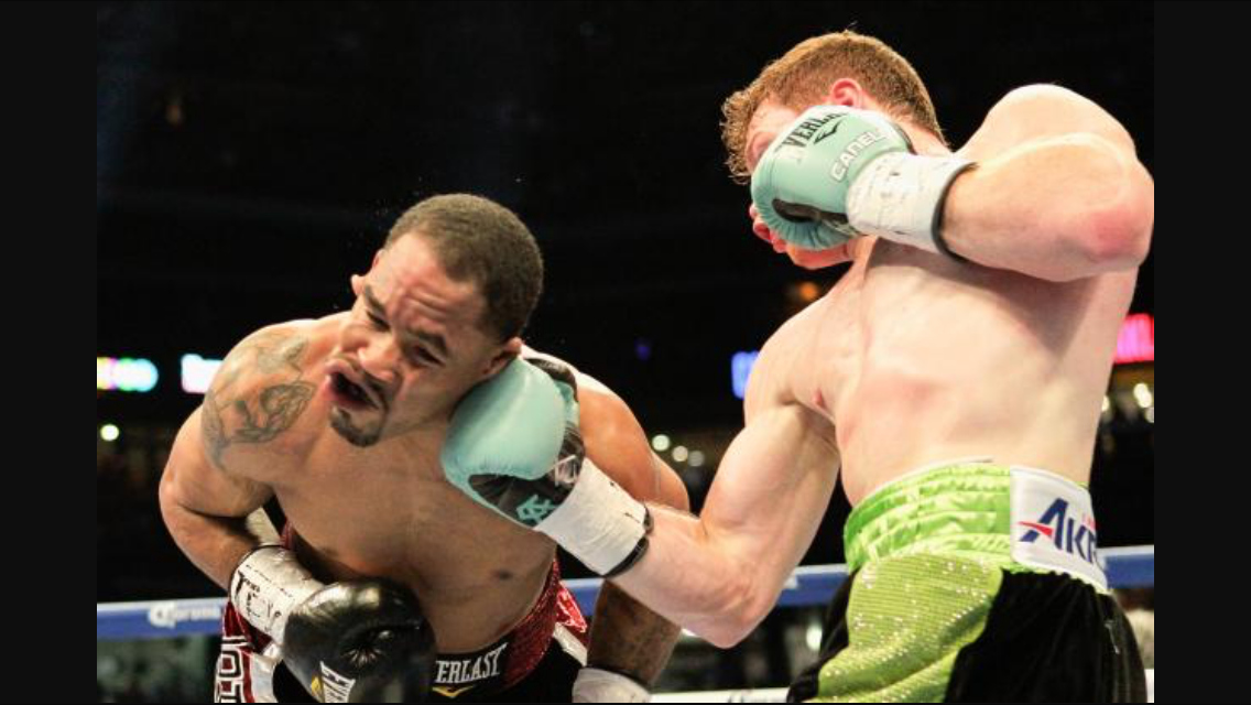 Canelo with another right uppercut on James Kirkland. Photo: Bob Levery/Associated Press