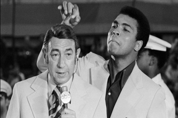 Mohammed Ali [right] toys with Sports broadcaster Howard Cosell [left] before the start of the of the Olympic boxing trials in West Point, New York on August 7, 1972. Photo: Associated Press