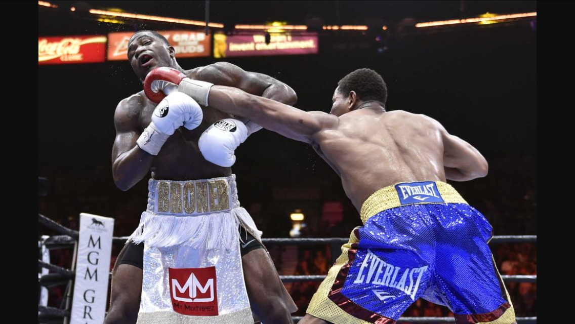 Shawn Porter lands a left jab on Adrien Broner. The bout took place at a catch weight of 144. Porter dominated the fight for 11 straight rounds. Photo: David Becker/AP