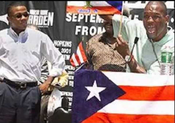 Bernard Hopkins taunts Felix Trinidad using the Puerto Rican Flag. Photo: Timothy A. Clary/ AFP Photo