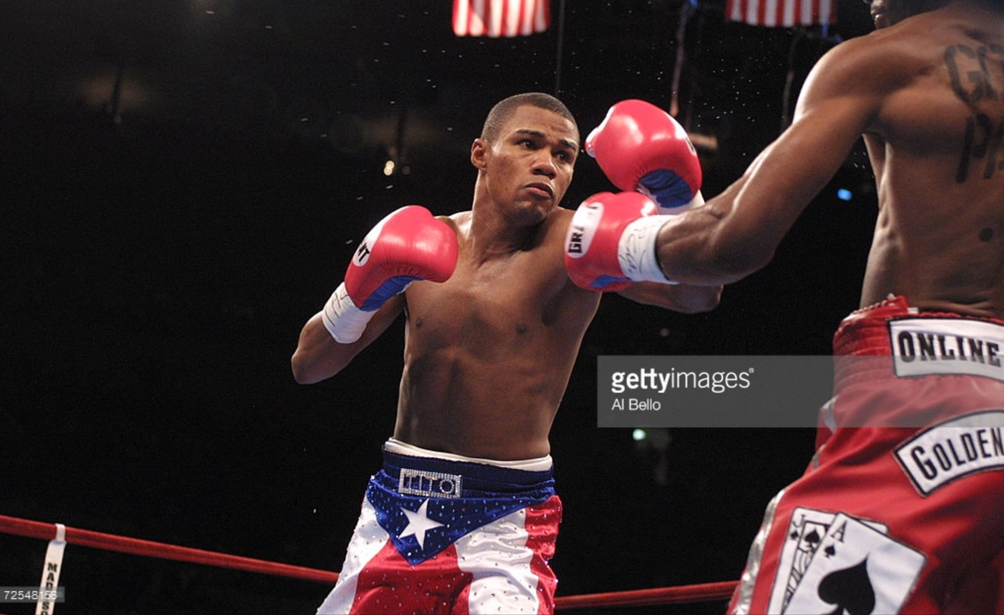 Felix Trinidad attempts to land a left jab on Bernard Hopkins. Photo: Al Bello/Getty Images