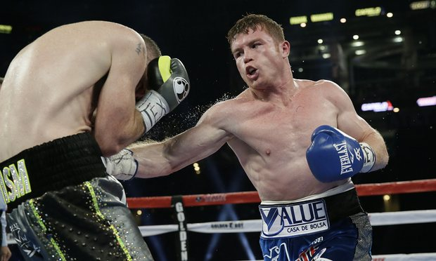 Canelo Alvarez lands a body shot on Liam Smith. Photo: LM Otero/AP