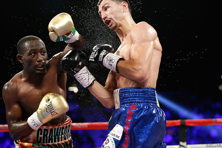 Terence Crawford lands a left hand on Viktor Postol in their 140-pound unification fight. Photo: Will Hart/HBO