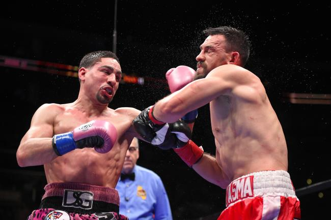 Danny Garcia lands a left hook on Robert Guerrero in their fight this past January. Photo: Mark J. Terrill/Associated Press