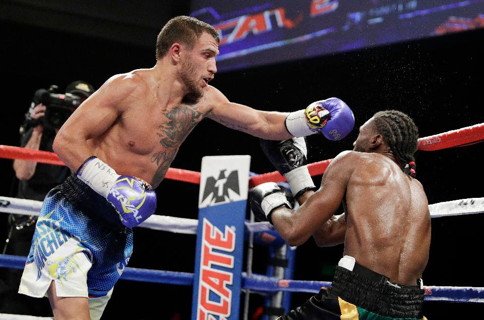 Vasyl Lomachenko lands a combination on Nicholas Walters. Photo: AP Photo/ John Locher