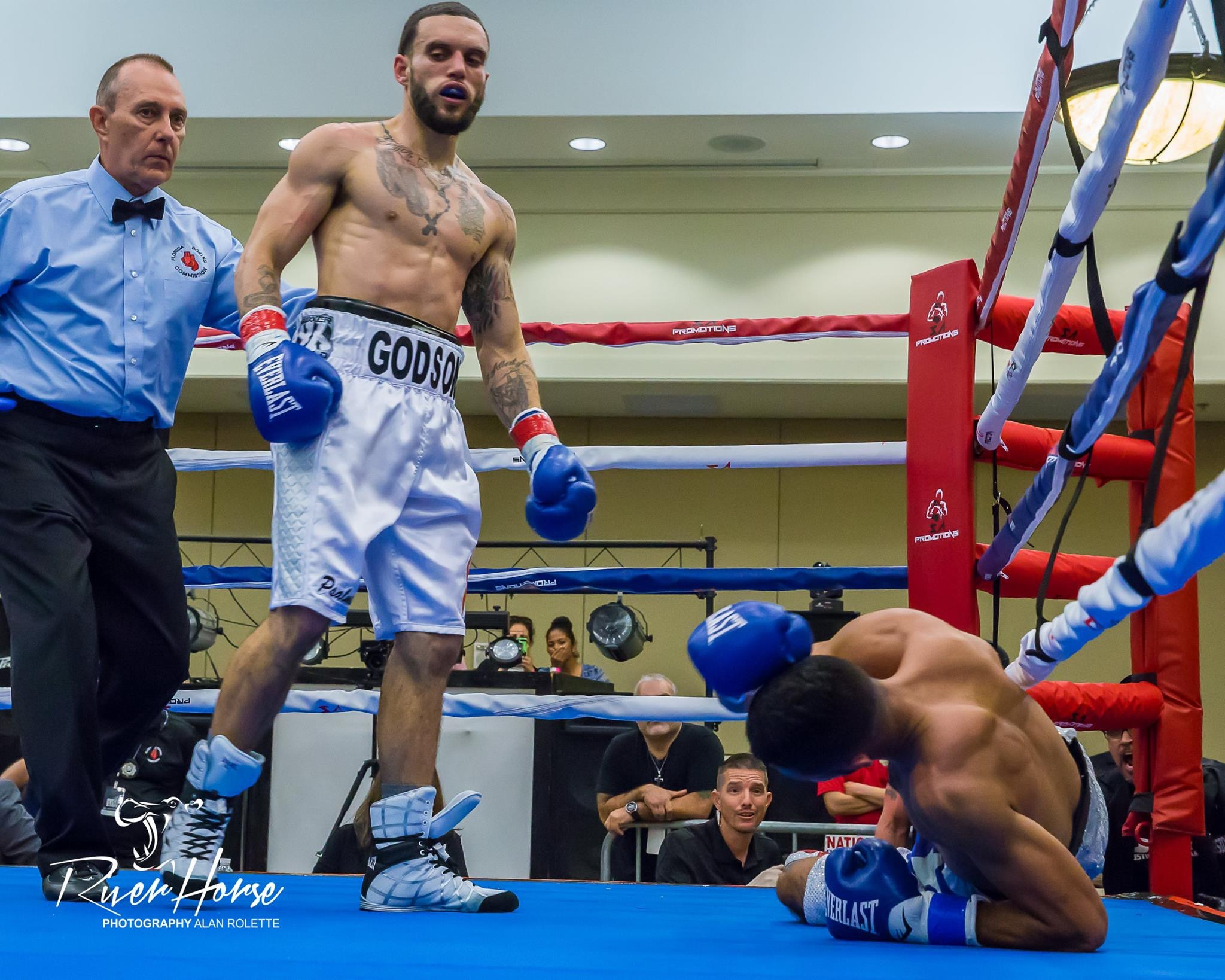 Dustin Arnold scores a knockdown on Evander Lamourt. Photo: Alan Rolette/RiverHorse Photography