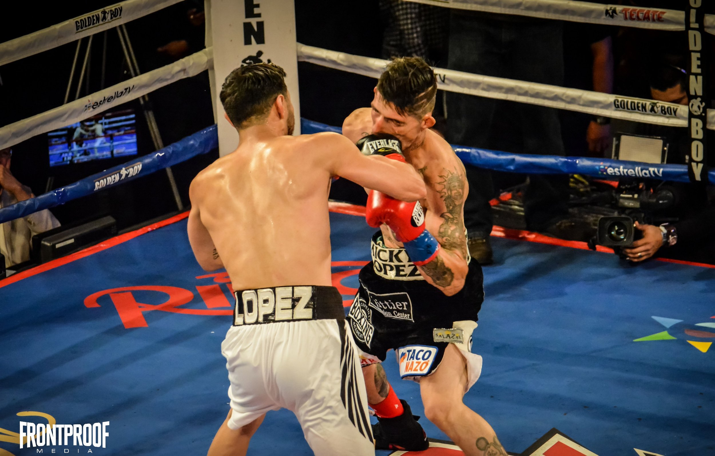 Abraham Lopez connects with a straight right on Sergio Lopez on Friday, December 2, 2016 in Los Angeles. Photo: Cynthia Saldaña/FrontProof Media