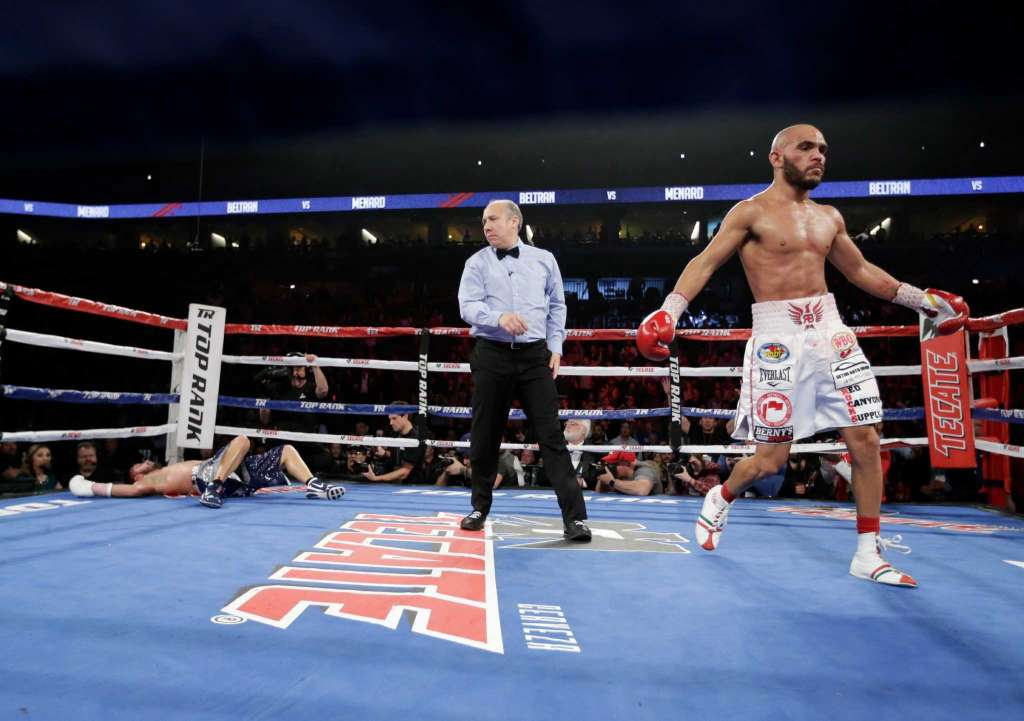 Ray Beltran moves to the corner after he lands the left hook that knocks out Mason Menard. Photo: Nati Harnik/AP