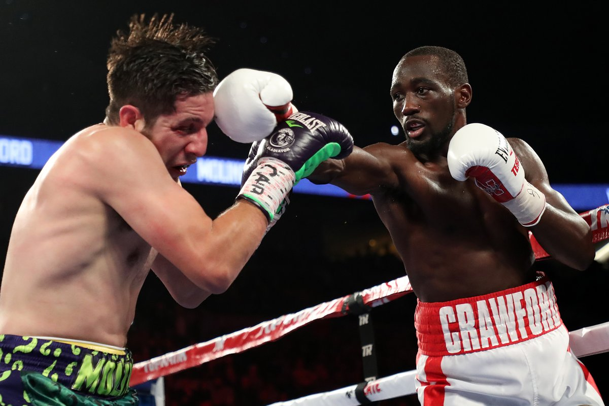 Terence Crawford lands a right jab on John Molina. Photo: Mikey Williams/Top Rank