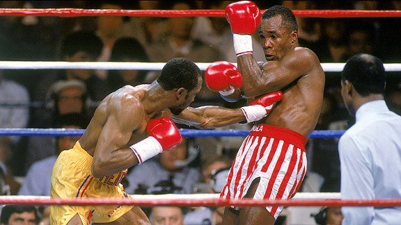 Thomas Hearns lands a left jab to the body on Sugar Ray Leonard in their 1989 rematch. Photo: Andrew D. Bernstein/Getty Images