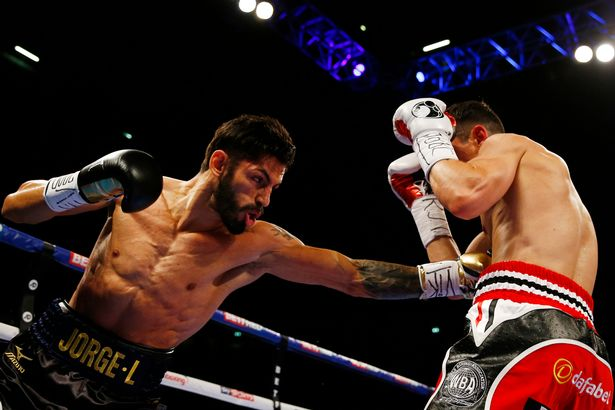 Jorge Linares lands a left jab to the stomach of Anthony Crolla in their WBA lightweight title fight last September. Photo: Action Images via Reuters
