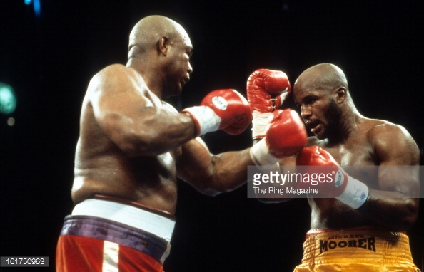 George Foreman in an exchange with Michael Moorer wherein victory he became the oldest heavyweight champion in boxing history. Photo: The Ring Magazine/Getty Images