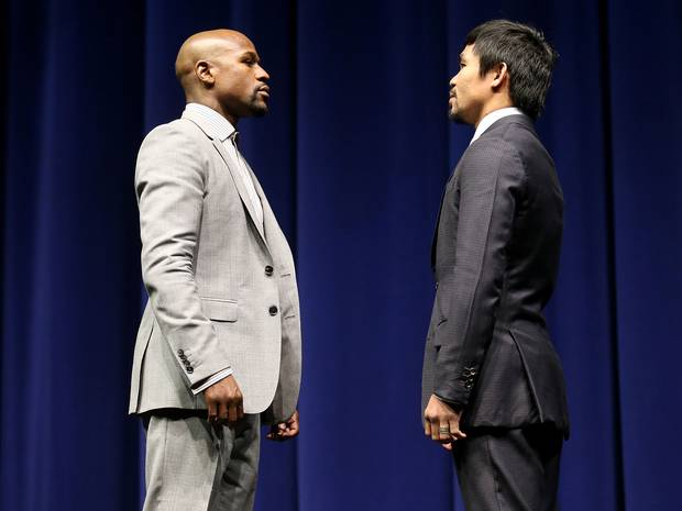 Floyd Mayweather and Manny Pacquiao face off in a press conference to promote their May 2015 mega bout. Photo: Stephen Dunn/Getty Images