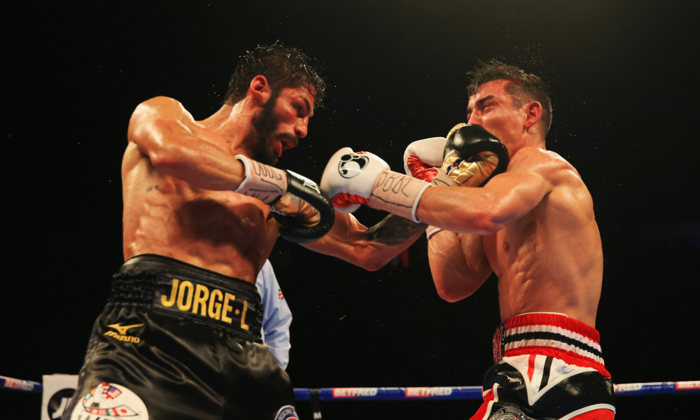 Jorge Linares lands a left uppercut on Anthony Crolla in their first bout that took place in September 2016. Linares won the fight via unanimous decision. Photo: Ben Hoskins/Getty Images