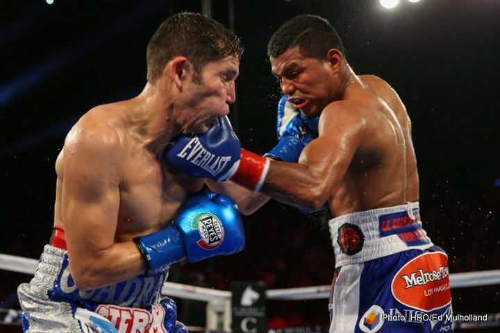 Roman Gonzalez and Carlos Cuadras trade left hooks in their September 2016 WBC 115-pound championship bout. Photo: Ed Mulholland/HBO