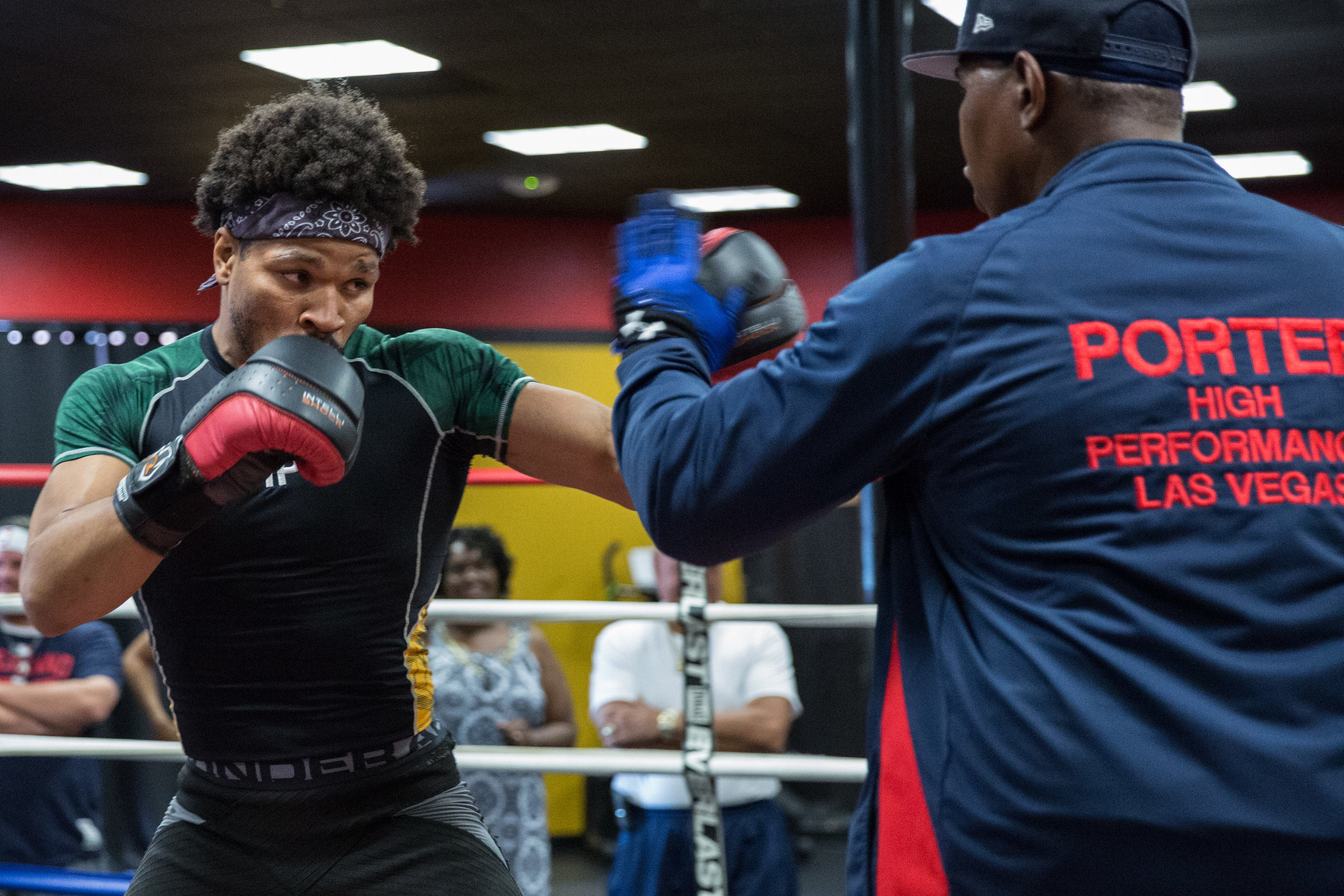 Shawn Porter doing mitt work with father Kenny. Photo Credit:Ryan Greene / Premier Boxing Champions