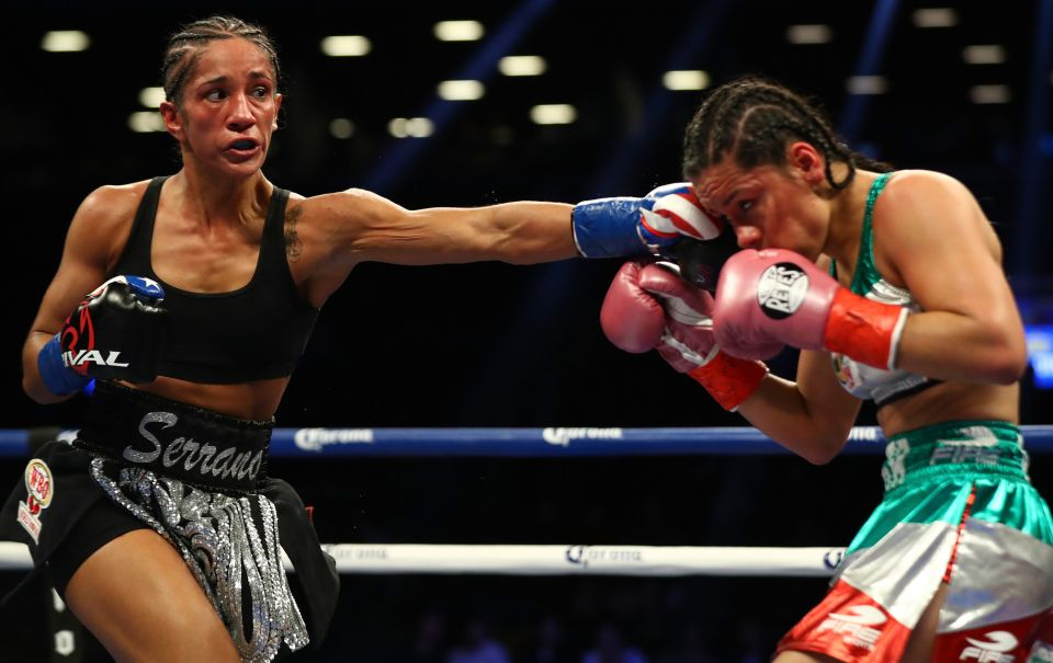 Amanda Serrano lands a left hand on Yazmin Rivas in route to a unanimous decision victory. Photo: Al Bello/Getty Images