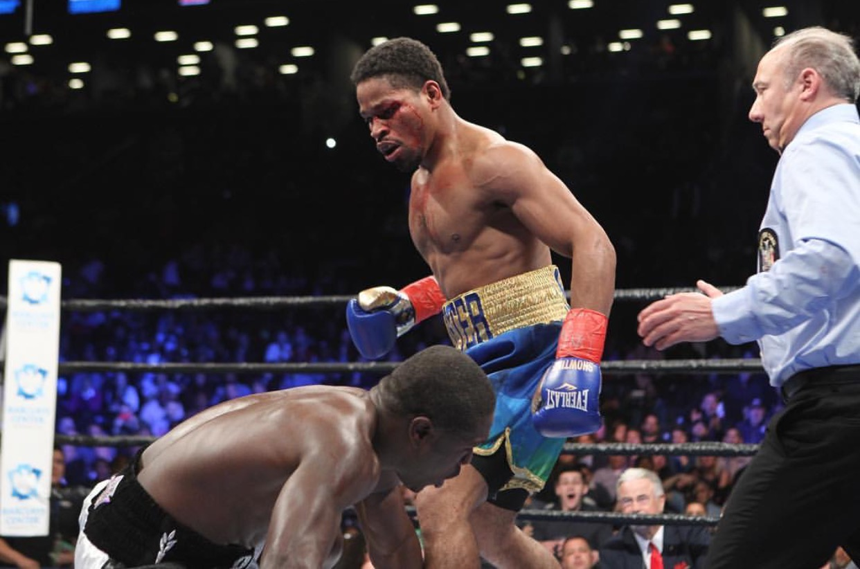 Shawn Porter stands over Andre Berto after scoring a knockdown. Photo: Amanda Westcott/Showtime