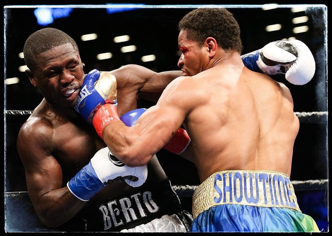 Shawn Porter lands a left hook on Andre Berto against the ropes. Photo: BigioShotYa