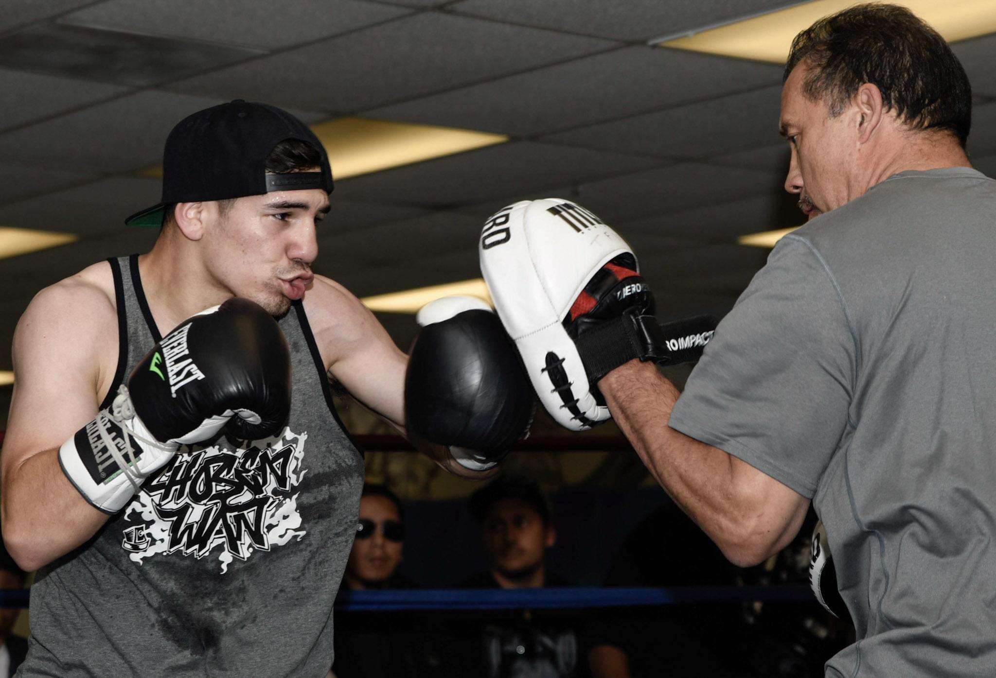 "Manuel ""Tino"" Avila on his media day hitting the pads. Photo: Julio C. Sanchez"