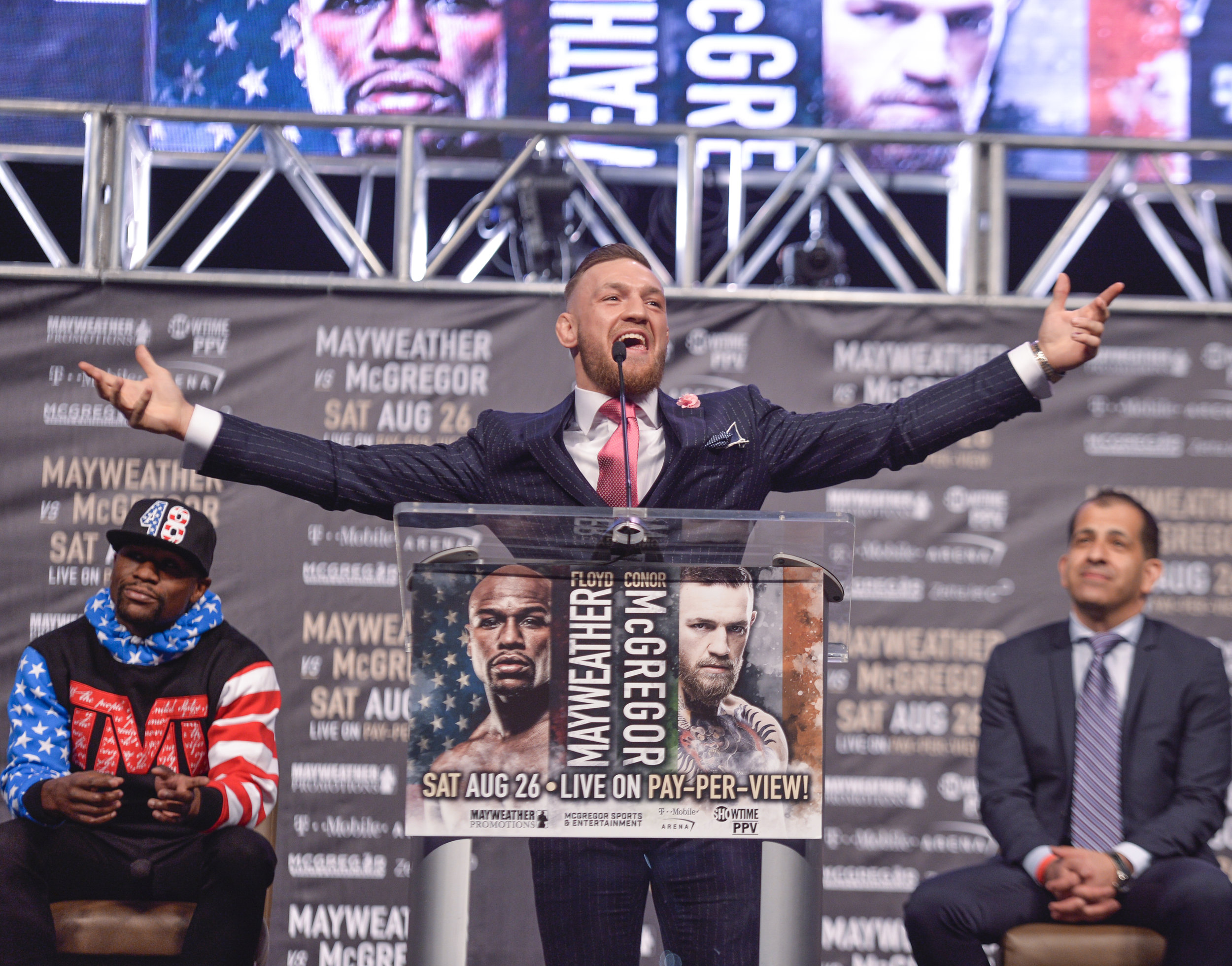 Conor McGregor takes a few stabs at Floyd at the podium  Photo Credit: Idris Erba/ Mayweather Promotions