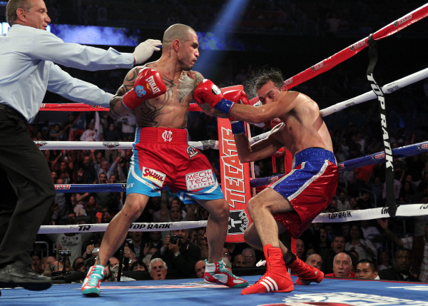 Miguel Cotto took out Delvin Rodriguez in the third round in Orlando, Florida. Photo: Chris Farina/Top Rank