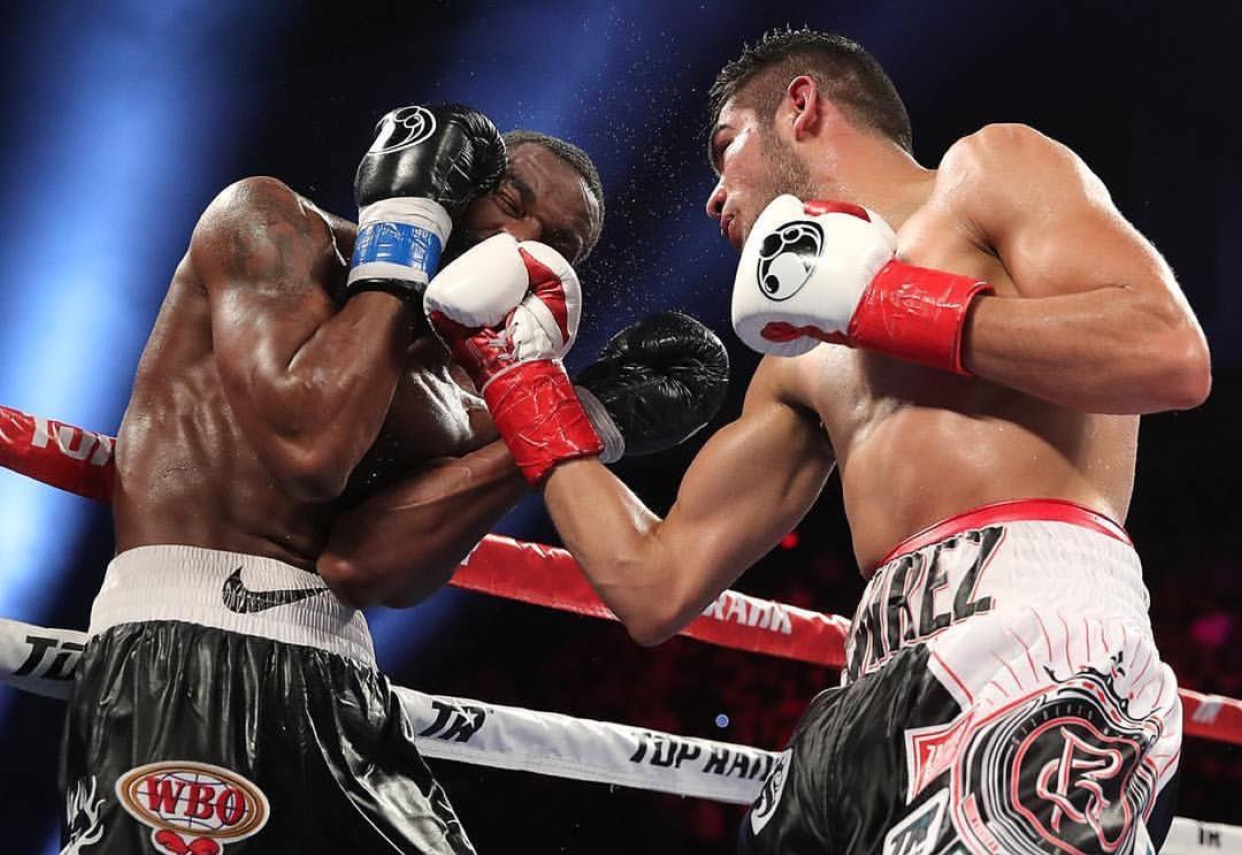 Gilberto Ramirez lands an uppercut on Jesse Hart in a great Super Middleweight title fight. Photo: Mikey Williams/Top Rank