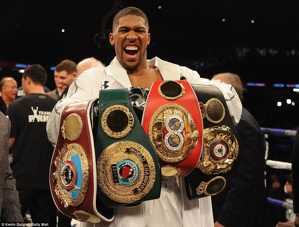 Anthony Joshua holding all four of his Heavyweight world titles. Photo: Kevin Quigley/Daily Mail