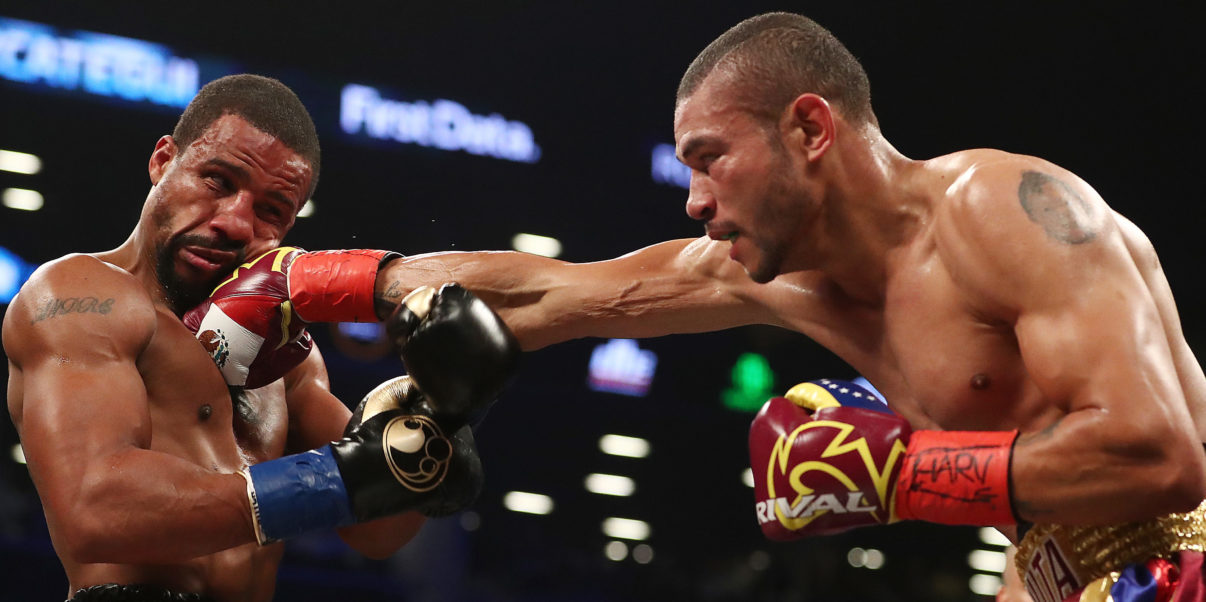 Jose Uzcategui lands a right hand on Andre Dirrell. Photo: Al Bello/Getty Images