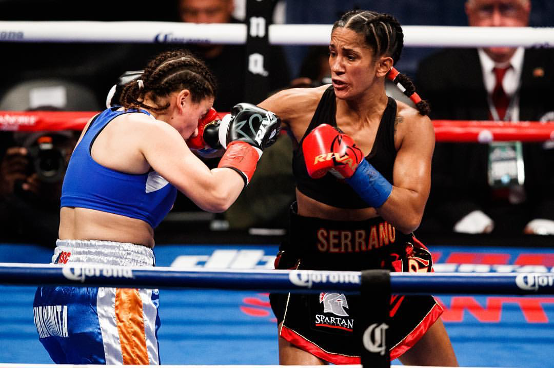 Amanda Serrano lands a right hand on Yamila Reynoso en route to a unanimous decision victory to make her just the third fighter in boxing history to win titles in six weight classes. Photo: Jose Miranda/Frontproof Media/jmjcinematics