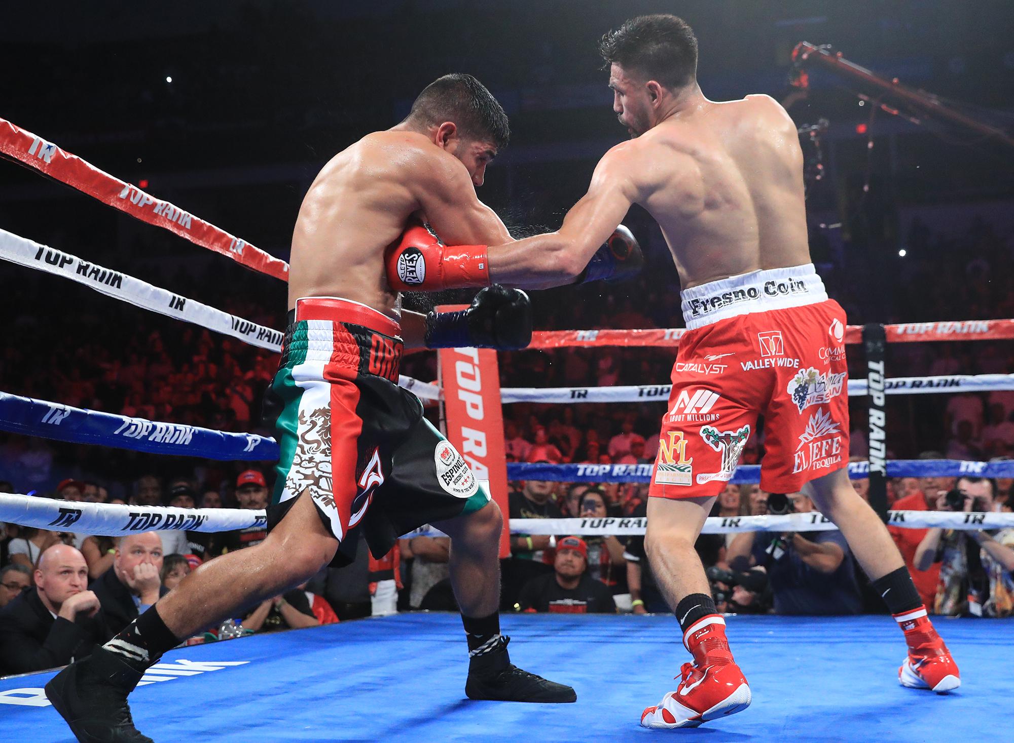 Jose Ramirez lands a body shot on Antonio Orozco. Photo: Mikey Williams/Top Rank