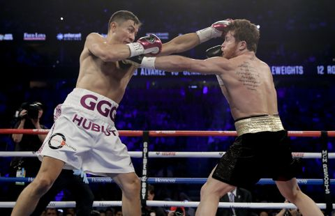 Canelo Alvarez and Gennady Golovkin exchange jabs in their highly anticipated rematch. Photo: Isaac Brekken/Associated Press