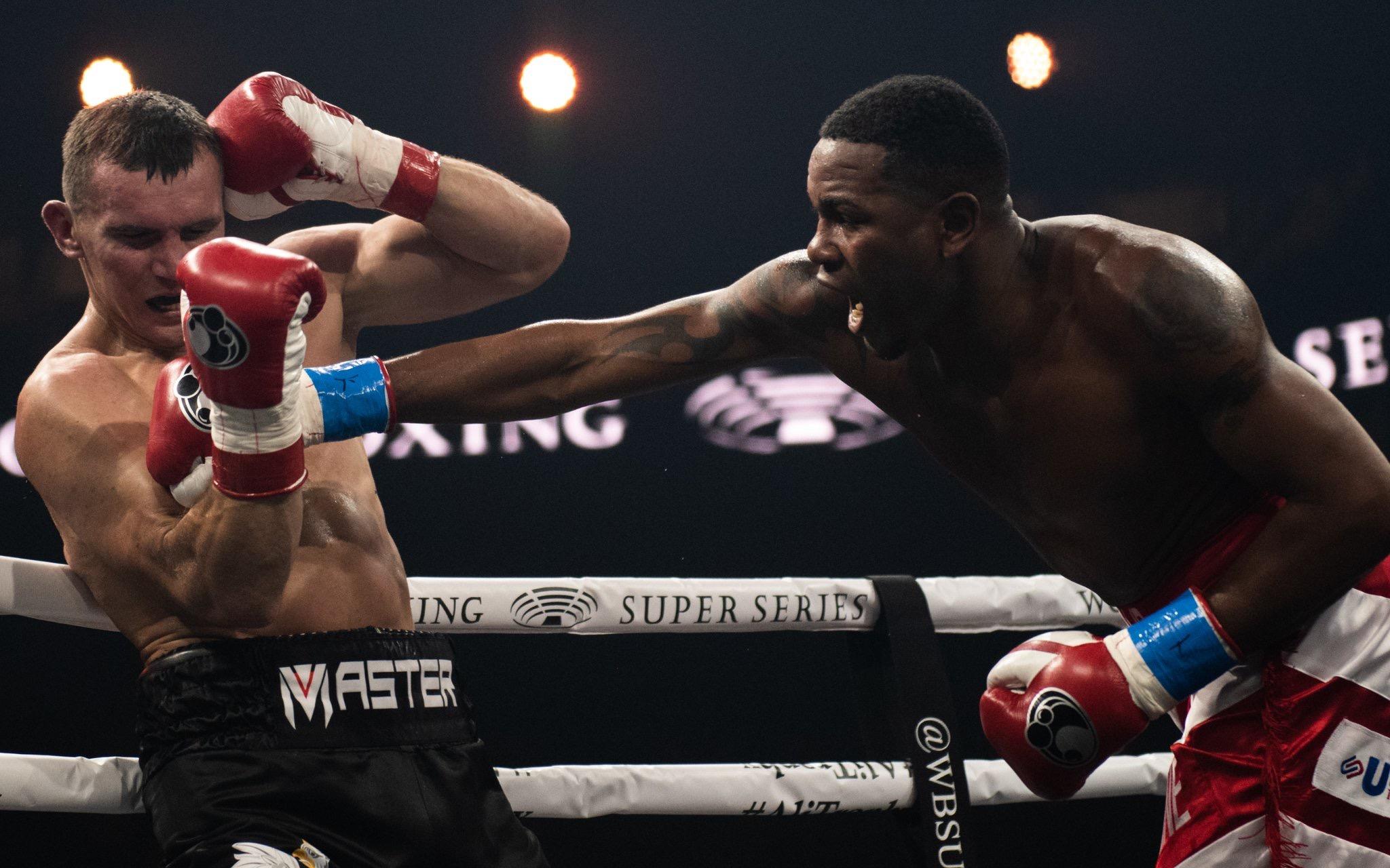 Yunier Dorticos lands a right hand on Mateusz Masternak. Photo: Lester Silva/World Boxing Super Series