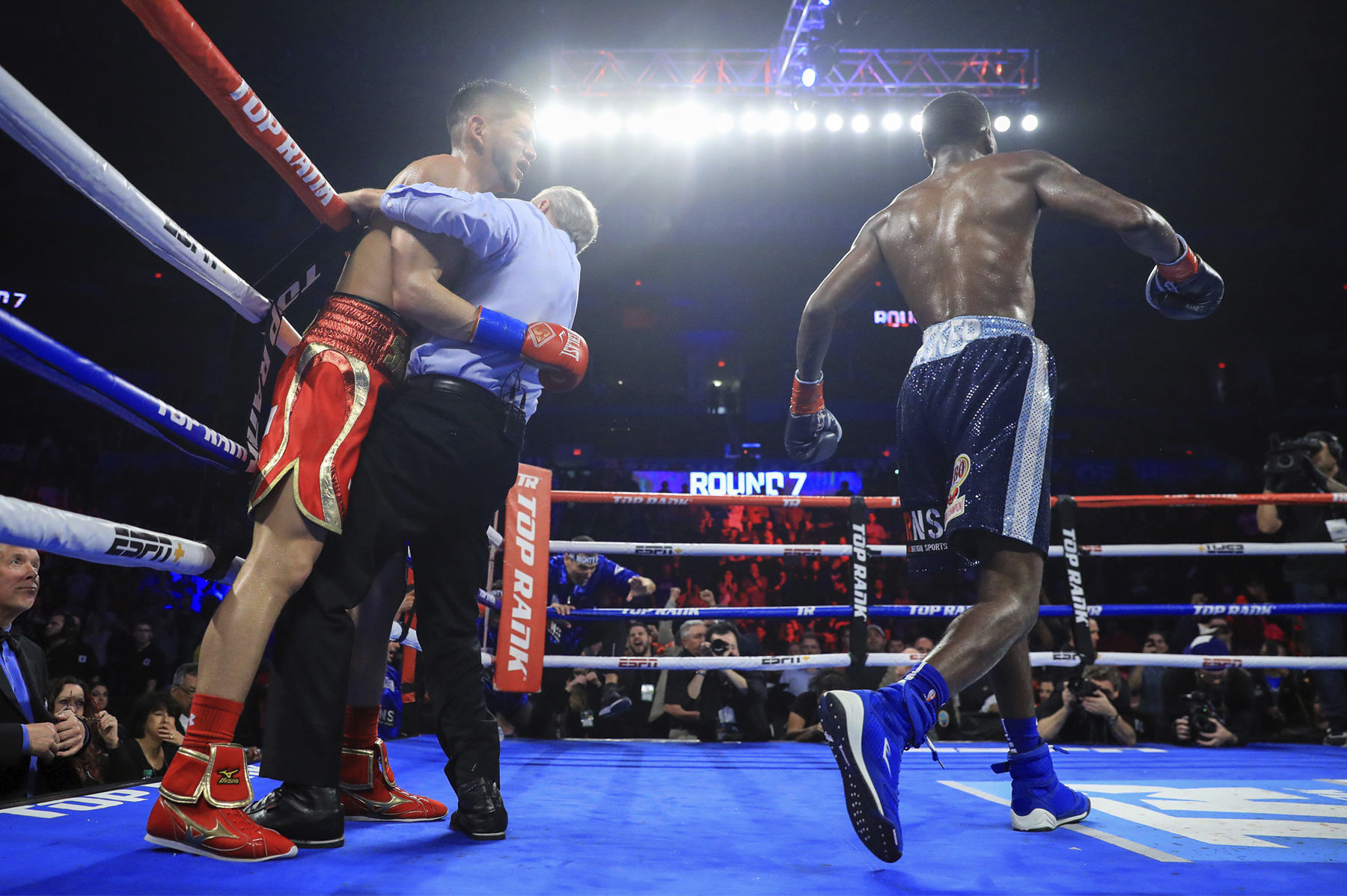 Maurice Hooker and Alex Saucedo right after the referee put a stop to the fight. Photo: Mikey Williams/Top Rank