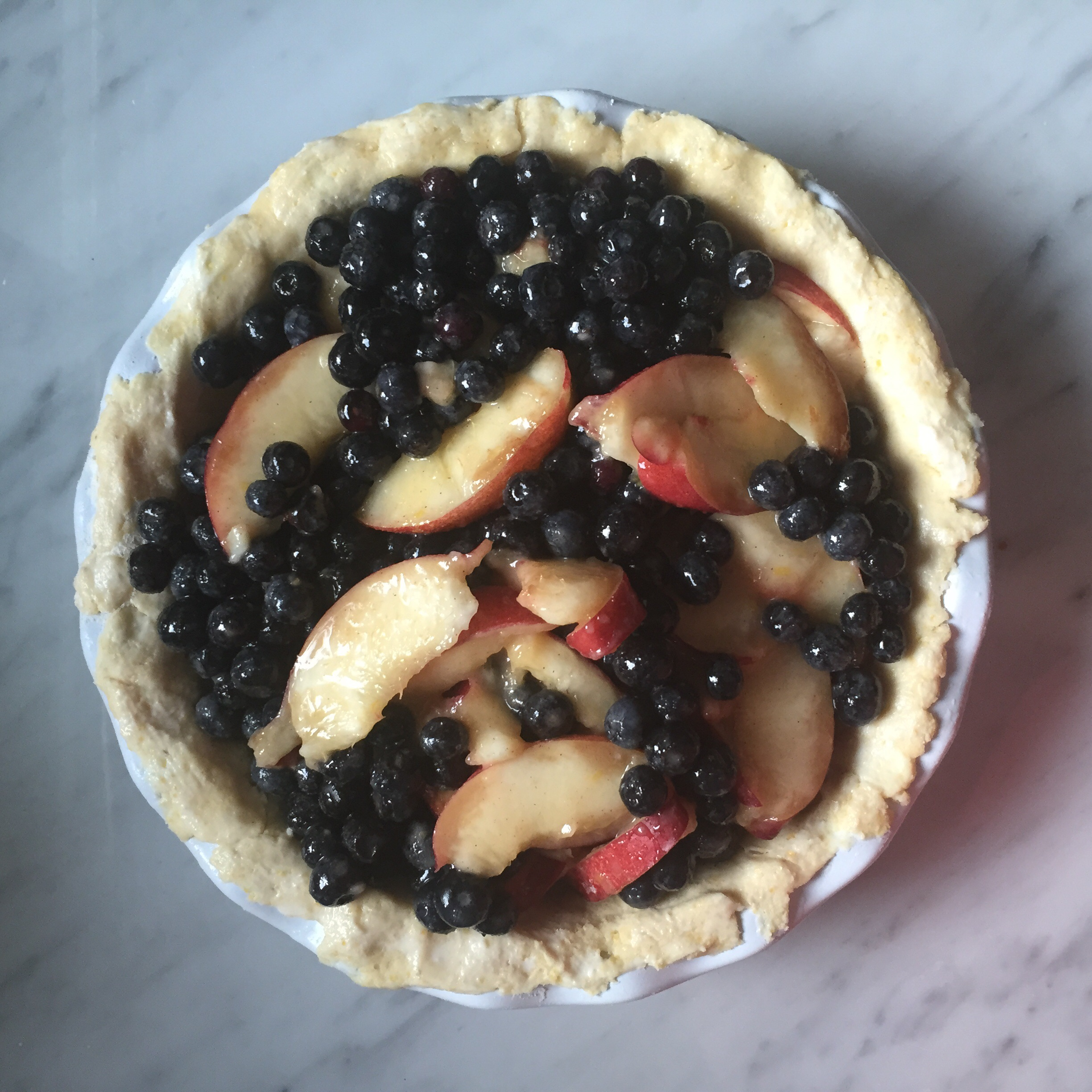 This is the pie I'm working on now- blueberry nectarine with cornmeal crust.