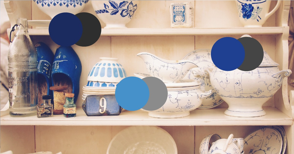 Same blue, different tone:  A collection of blue and white china and complimentary decor pieces using the same blue in different tones.