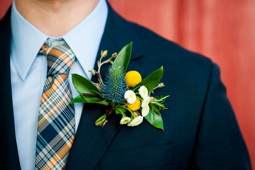 Boutonniere of Chamomile, thistle, and Billy Balls.