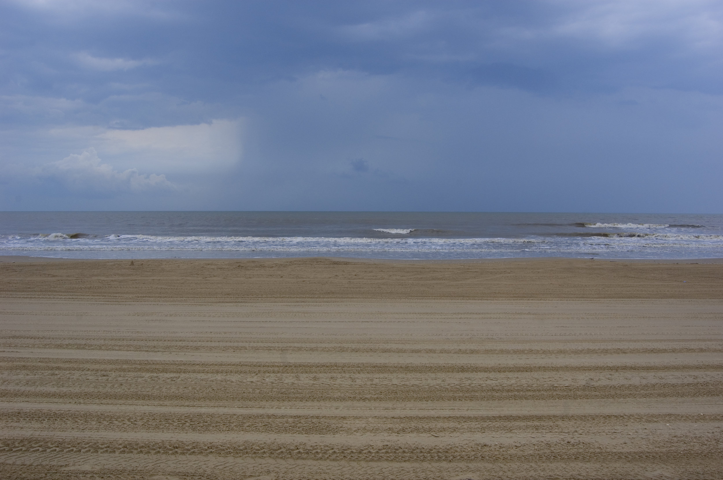 Crystal Beach with off-shore rain showers.