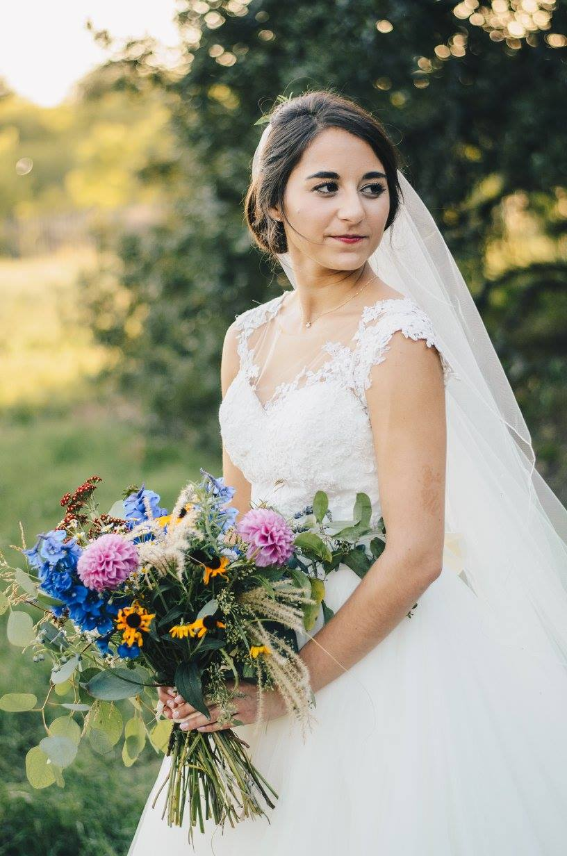 These outdoor shots captured by Kat/Eye Studios are absolutely stunning. The evening light was perfect, and this wildflower bouquet blends naturally.   Photo credit:  Kat/Eye Studios