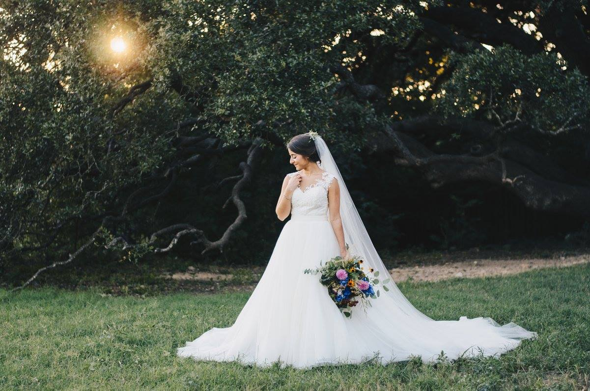 Sarah made such a sweet bride, and is totally encompassed by a Texas Hill Country signature, the escarpment live oak.   Photo credit:  Kat/Eye Studios
