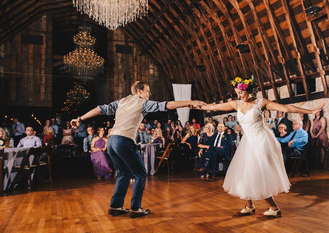 Sarah wanted a flower crown with all of the colors from the wedding, and she got it! Eric and Sarah are dancers, and they really strutted their stuff at the reception with a choreographed show.  Photo credit:  Kat/Eye Studios