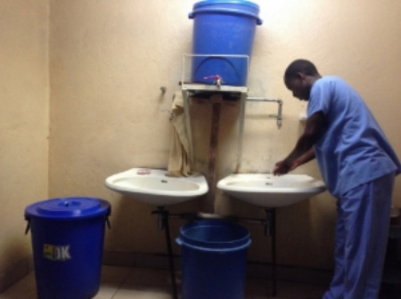 A medical student scrubbing in at the surgical sink.