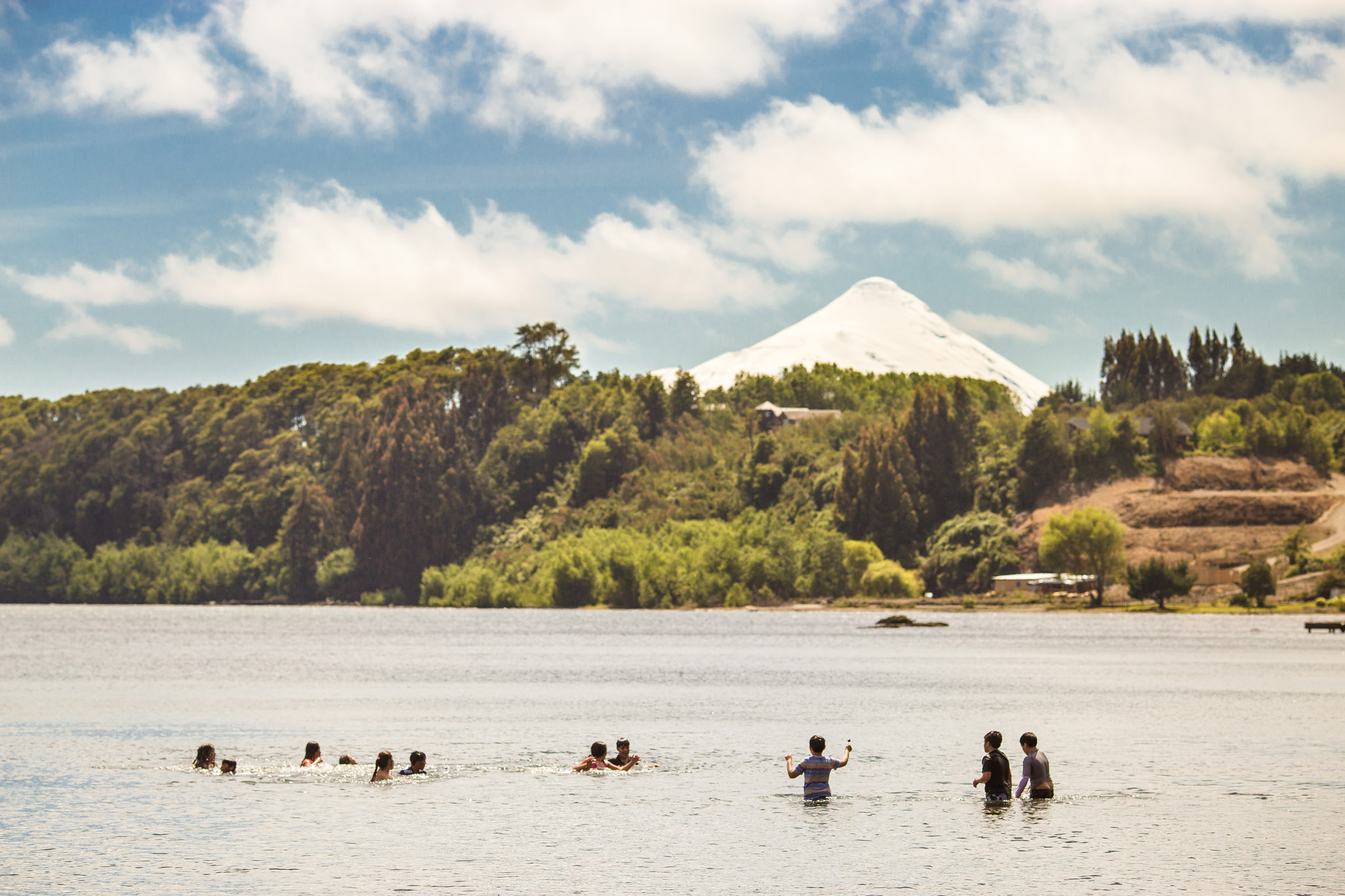 There aren't many countries where you can swim or windsurf on a lake, with a backdrop of a volcano